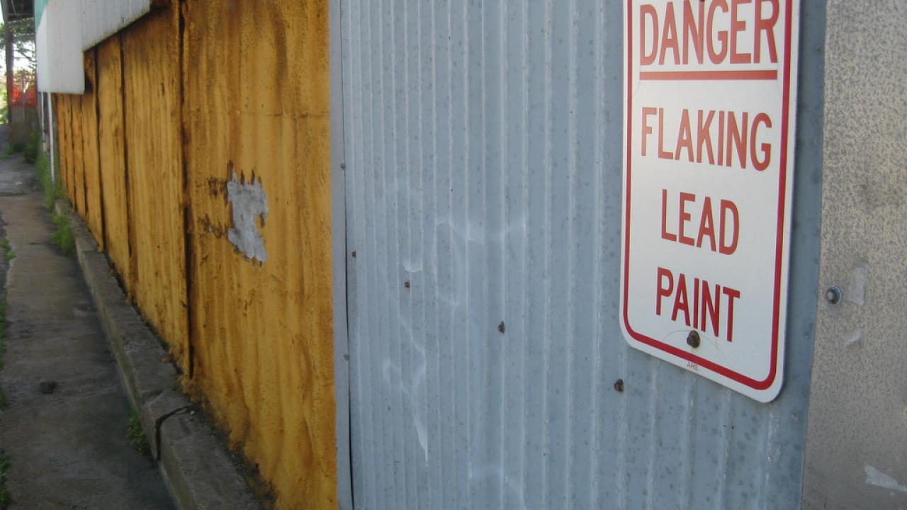Flake paint wall with danger sign attached