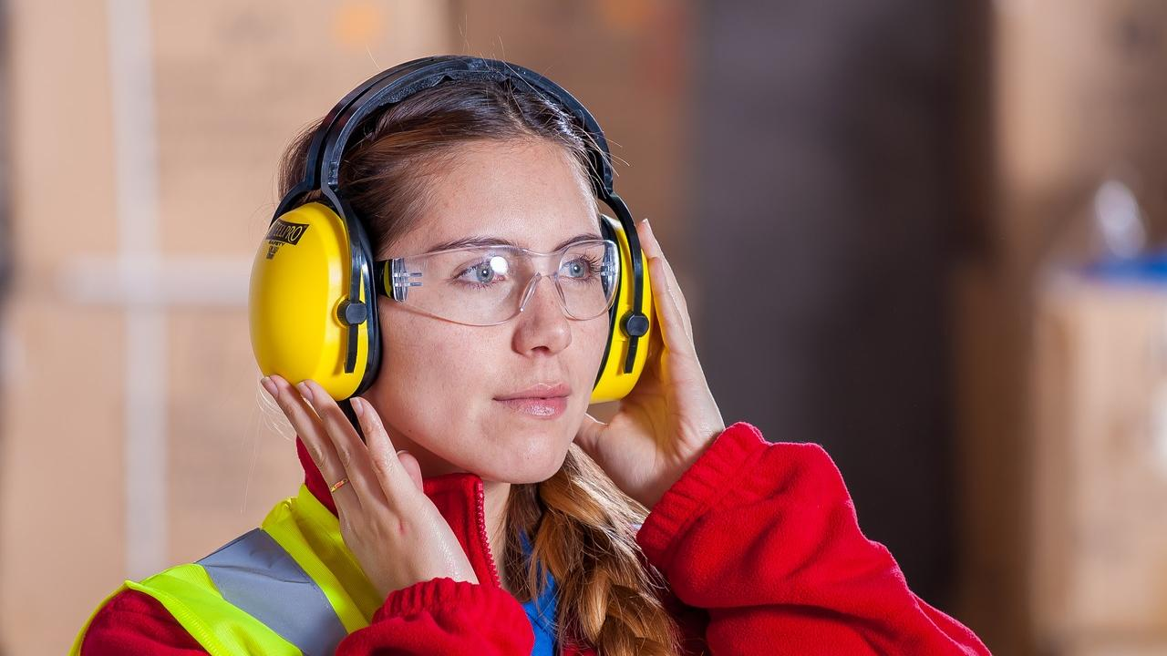 Female worker wearing hearing protection