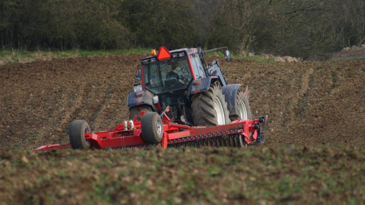 Red tractor working in a field