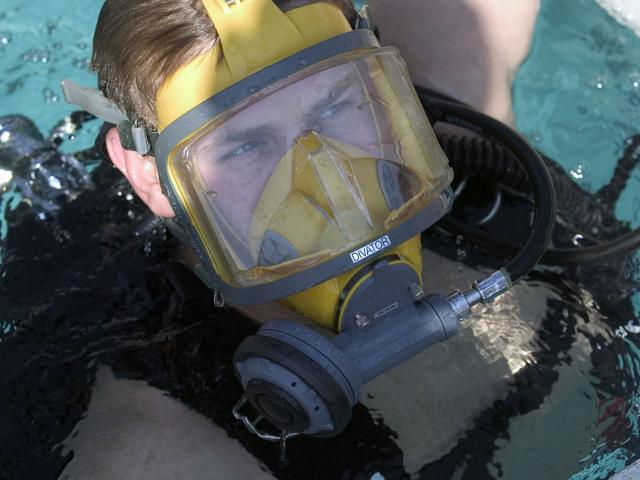 Man in diving equipment in the water