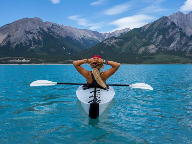 Woman relaxing on a kayak