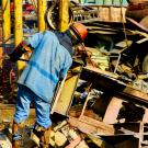 Man working in metal scrap yard