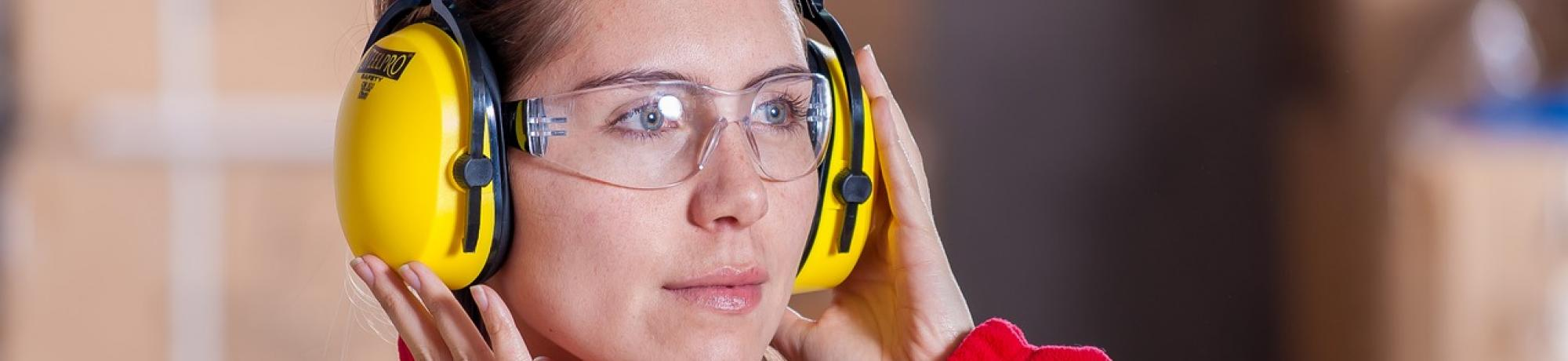 Woman adjusting her ear protection