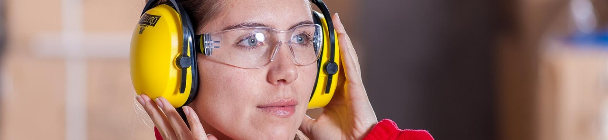 Female industrial worker wearing hearing protection