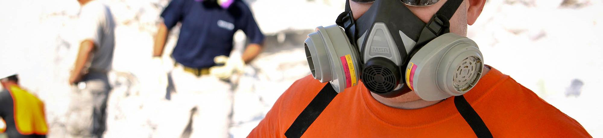 industrial worker wearing a half face respirator
